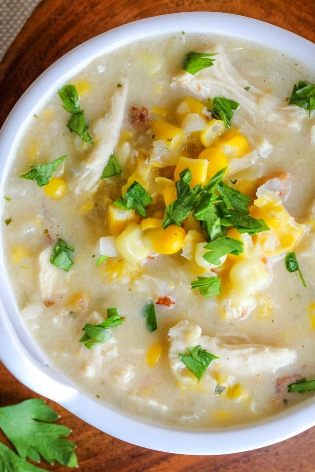 closeup overhead of about 2/3 of a bowl of this corn chowder in a white bowl