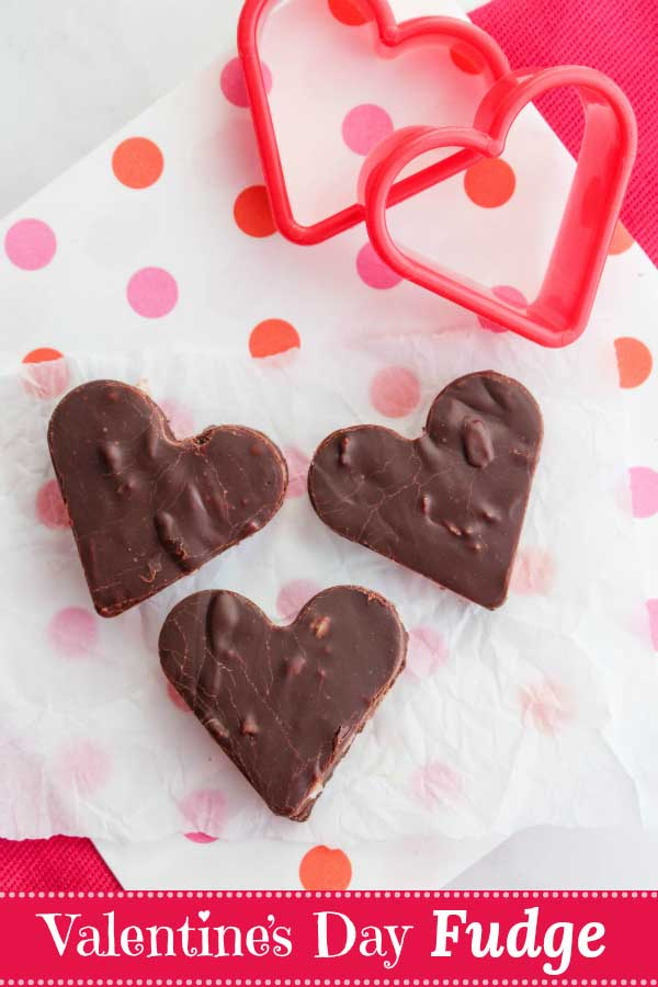 Incredibly simple, 4-ingredient fudge takes just 5 minutes to prep! Melt-in-your-mouth, creamy fudge with no butter, or loads of extra sugar or sweetened condensed milk (like with so many traditional recipes)! Deep, dark chocolate with just a hint of coconut! The perfect recipe for Valentine's Day ... all the yumminess with none of the guilt! #Valentine #fudge #Valentines #ValentinesDay #chocolate #hearts #DIYgifts #chocolaterecipes #healthyrecipes #healthydessert | www.TwoHealthyKitchens.com