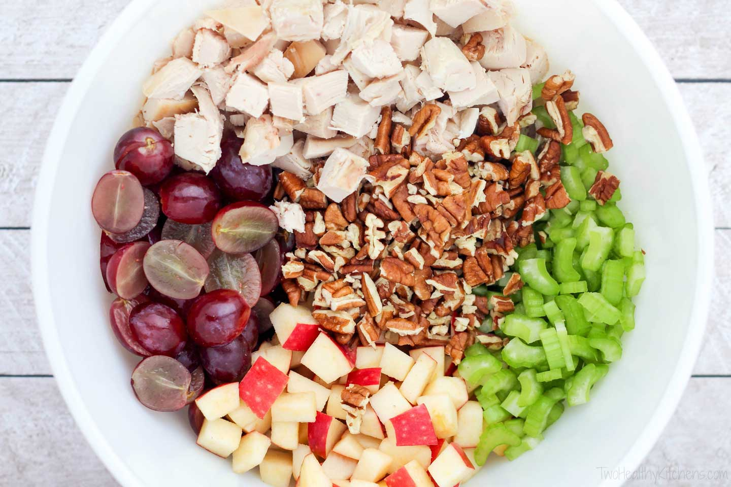 Chicken salad with grapes is always a refreshing twist, and the addition of sweet-tart apples and crunchy pecans is even better! Plus … there's that secret ingredient: tarragon in the yummy Greek yogurt dressing!