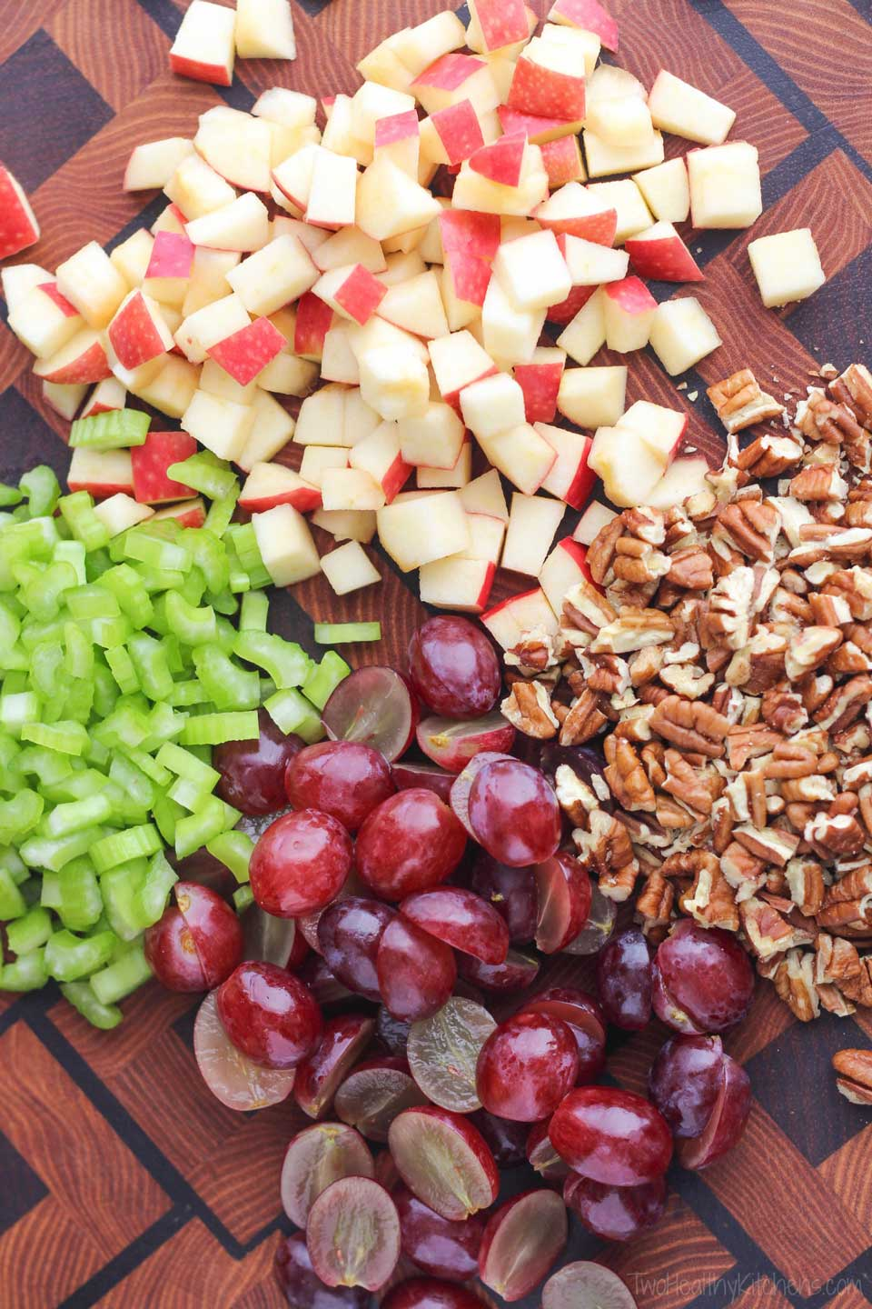 The ingredients for this healthy chicken salad include fresh, juicy grapes, crisp apples and crunchy pecans. So delicious!