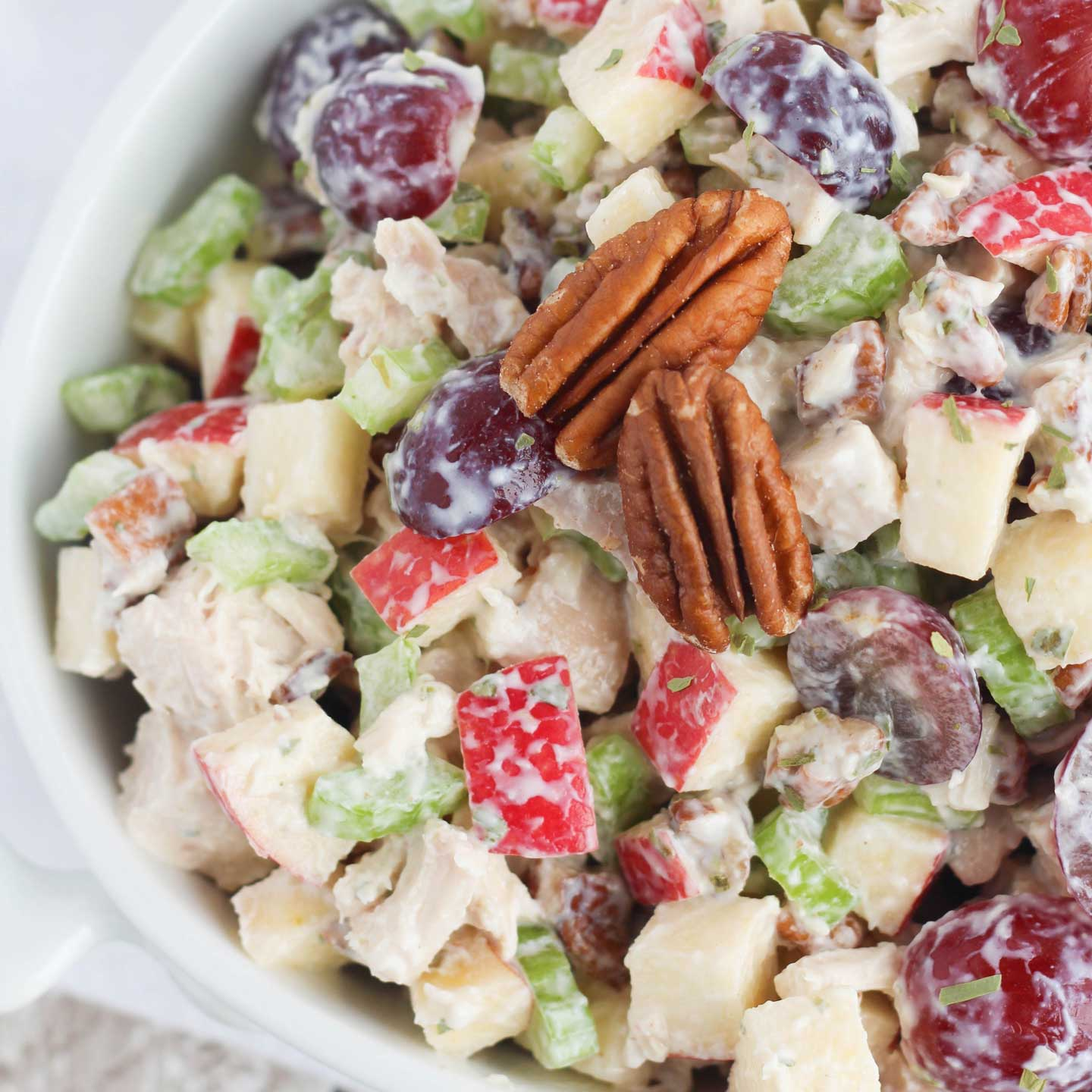 Similar to Arby's chicken salad, this loaded version is a chicken salad with grapes, apples, celery and pecans ... plus the crowning flourish of tarragon for something truly special!