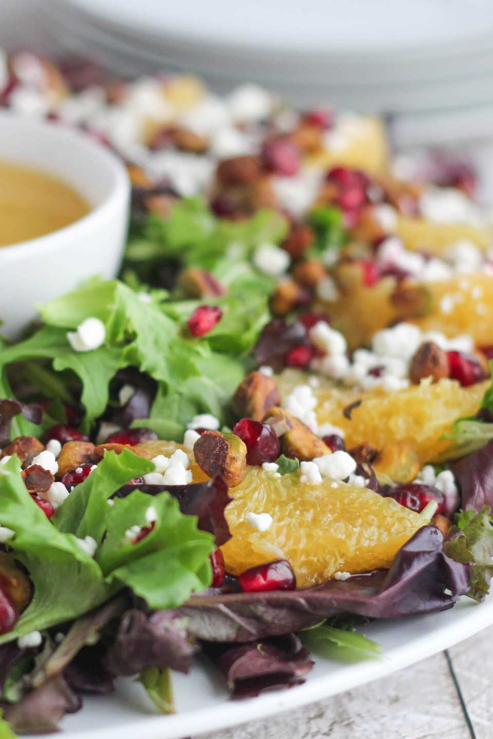This Christmas Salad with goat cheese, pomegranate arils, crunchy pistachios, and juicy orange slices is a showstopper!