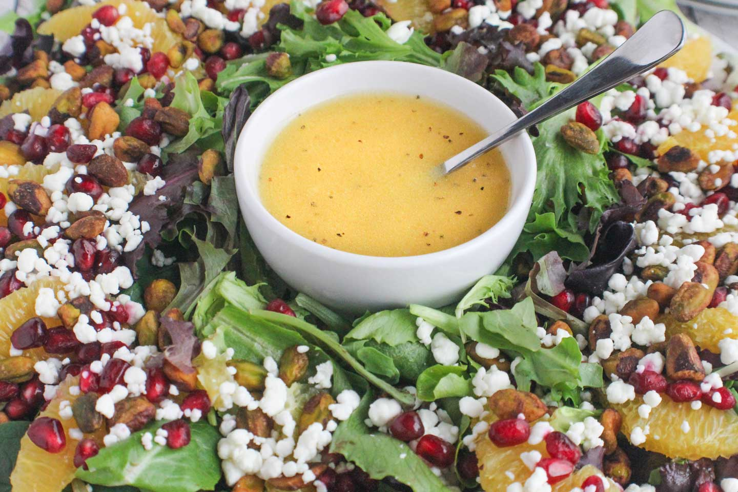 The easy Citrus-Champagne Vinaigrette is the perfect festive accompaniment to our holiday salad recipe!