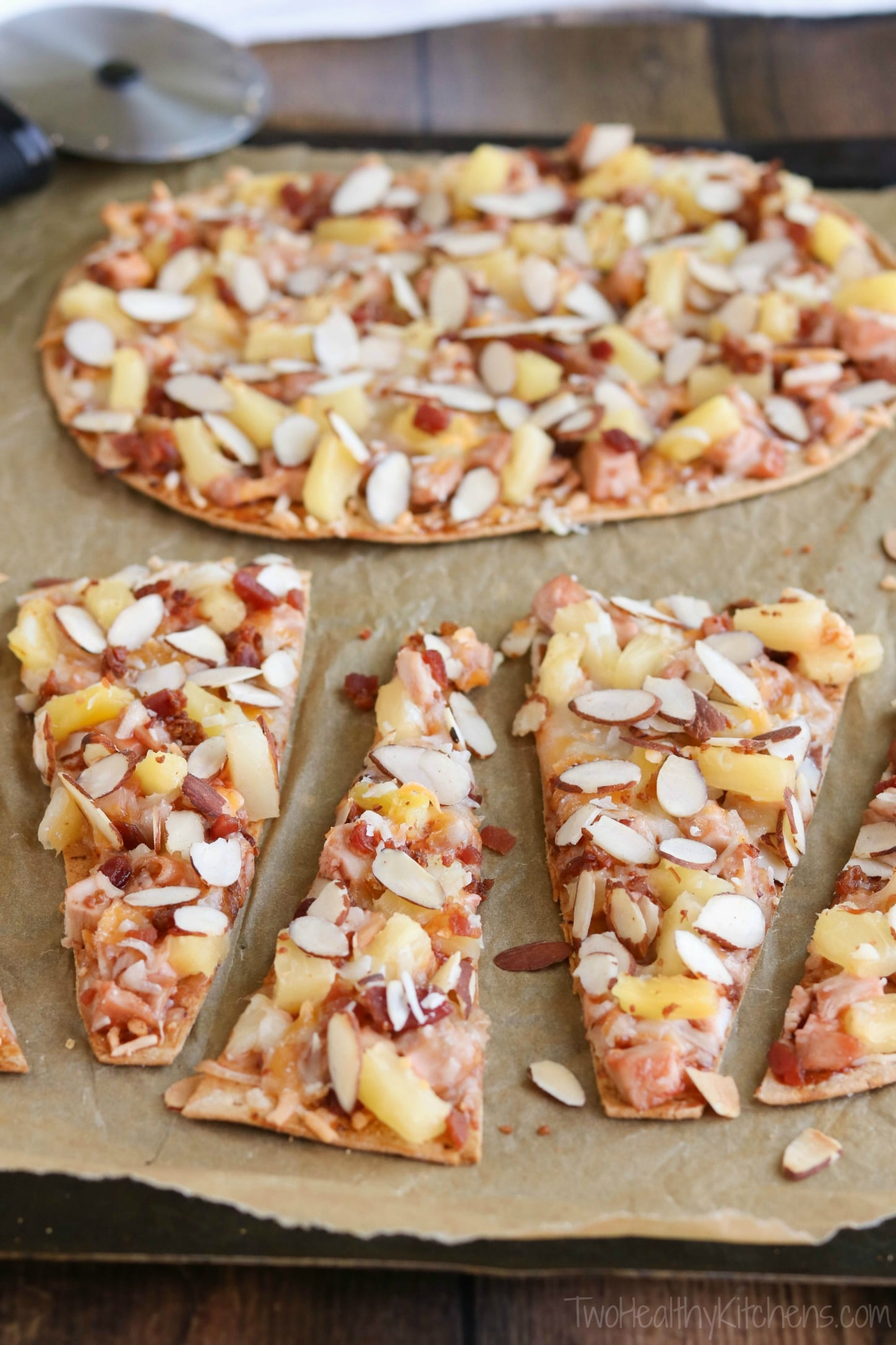 This Sweet and Sour Chicken Flatbread Pizza is so many awesome things in one! It's like your favorite Chinese sweet and sour chicken met up with a BBQ chicken pizza … all on top of a crispy flatbread crust! Bonus: it's ready in way under 30 minutes! {ad} | www.TwoHealthyKitchens.com