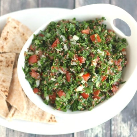 Just a few simple ingredients - so easy! This Kale and Quinoa Tabouli Salad has all the bright flavors you expect in tabouli, plus super-healthy kale (you won't even taste it - seriously!), and gluten-free quinoa instead of bulgur wheat! Makes a big batch and keeps really well – a perfect make-ahead recipe! | www.TwoHealthyKitchens.com