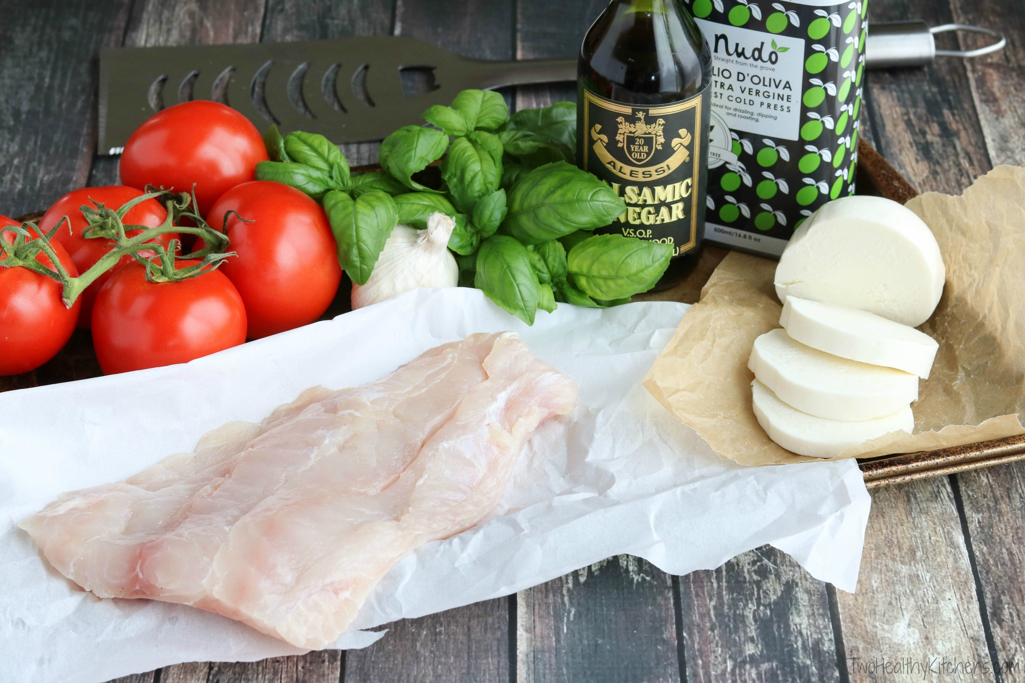 Caprese Grilled Fish is super simple yet incredibly delicious - perfect with summer's best tomatoes and basil! An easy grilling recipe for cookouts or casual family suppers!   www.TwoHealthyKitchens.com