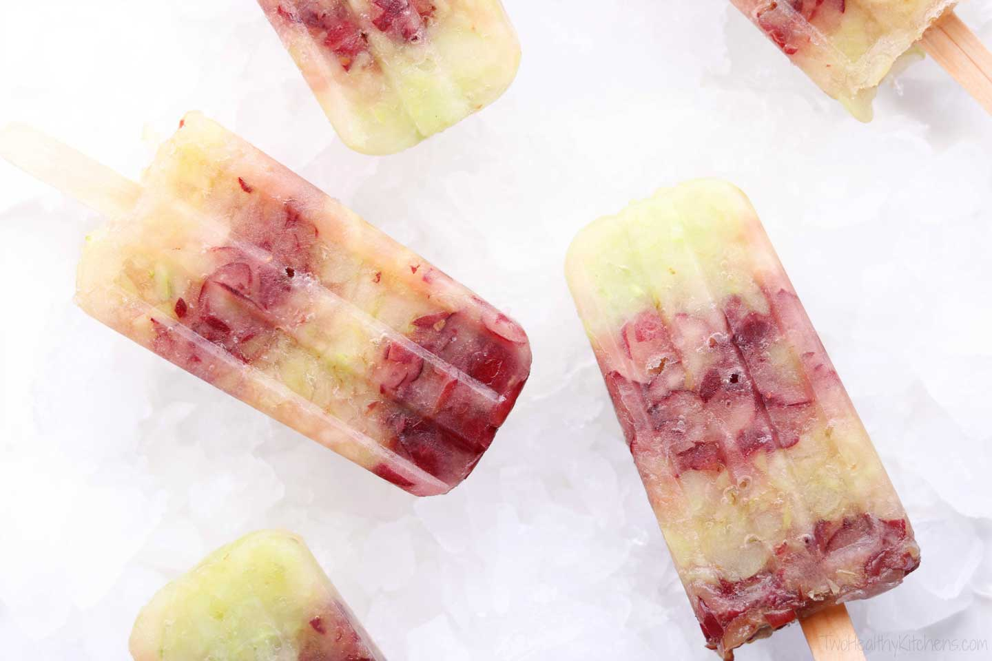 Frozen grapes are deliciously transformed into perfectly simple, amazingly refreshing popsicles! So easy to make! My absolute favorite summer post-workout snack! | www.TwoHealthyKitchens.com