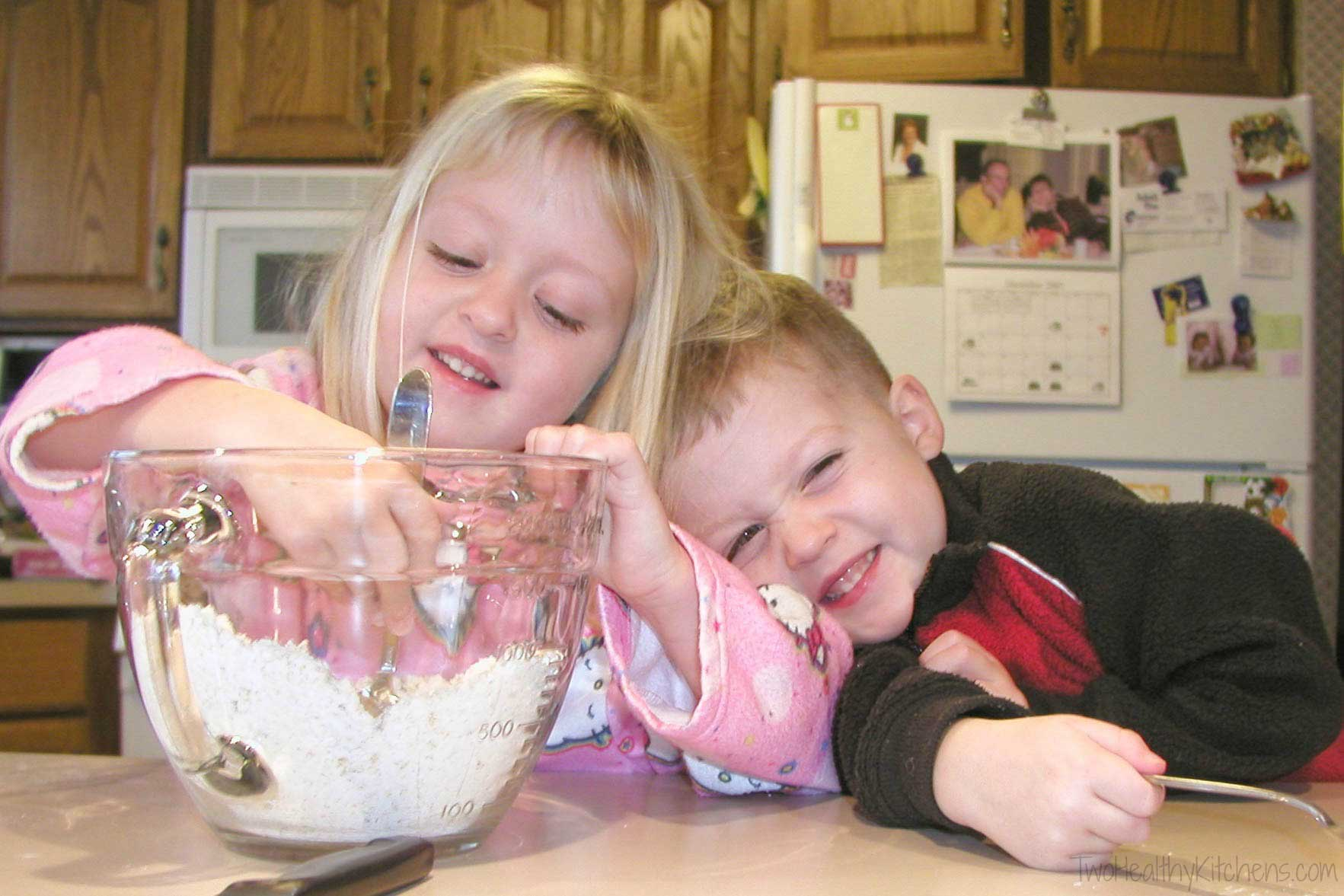 my kids giggling together as they mix ingredients together