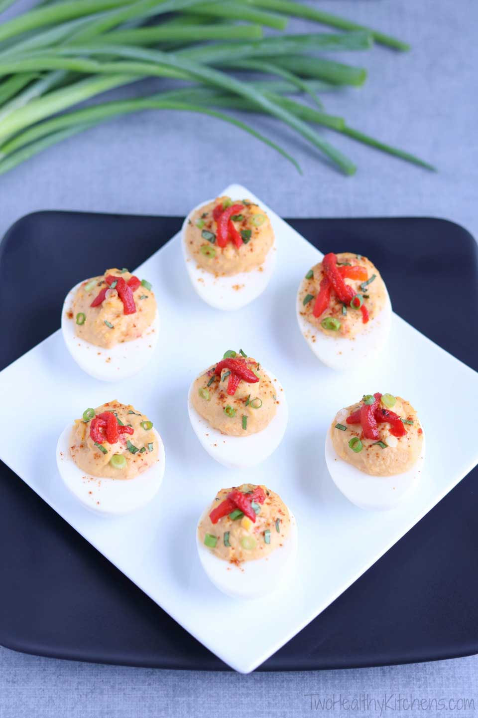 An easy, protein-packed, make-ahead! This Mediterranean Hummus Deviled Egg recipe features creamy roasted red pepper hummus and fresh basil. Fast enough for last-minute picnics and tailgates, yet stunning enough for fancy hors d'oeuvres parties!