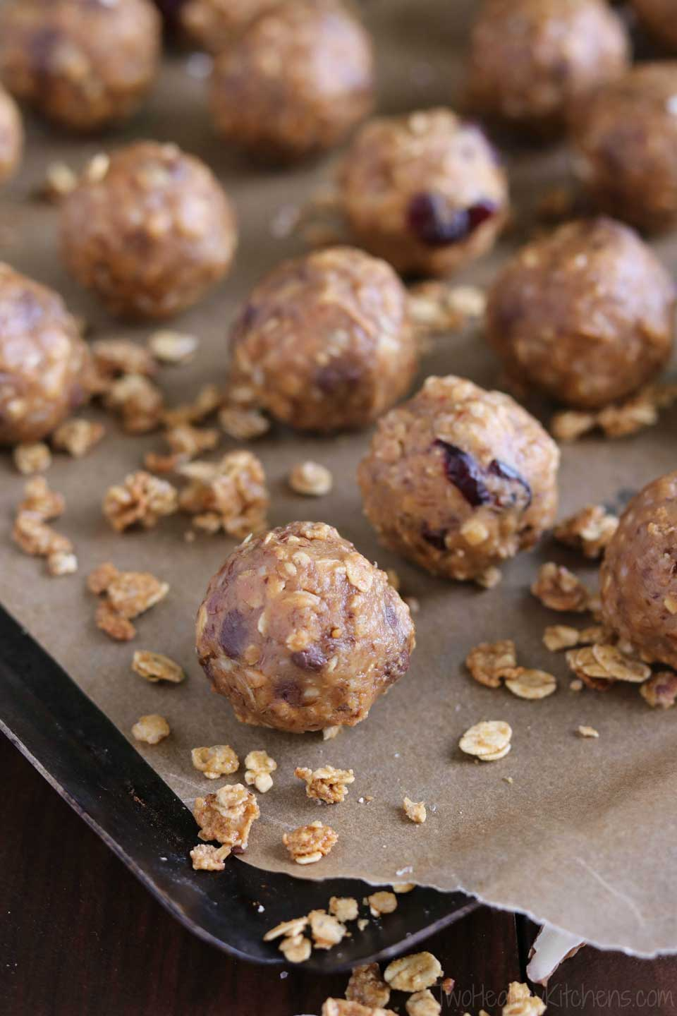 Freezable, no-bake Energy Balls with protein and whole grains! These Crunchy Granola Snack Bites will keep you satisfyingly full and power you through whatever the day might hold. A perfect healthy snack recipe, or a grab-and-go, make-ahead breakfast recipe! With peanut butter, oats, flax, and granola, plus dried fruit or chocolate chips - these energy bites are crunchy, chewy, and delicious! A healthy recipe with a few simple ingredients you probably have on hand!   www.TwoHealthyKitchens.com