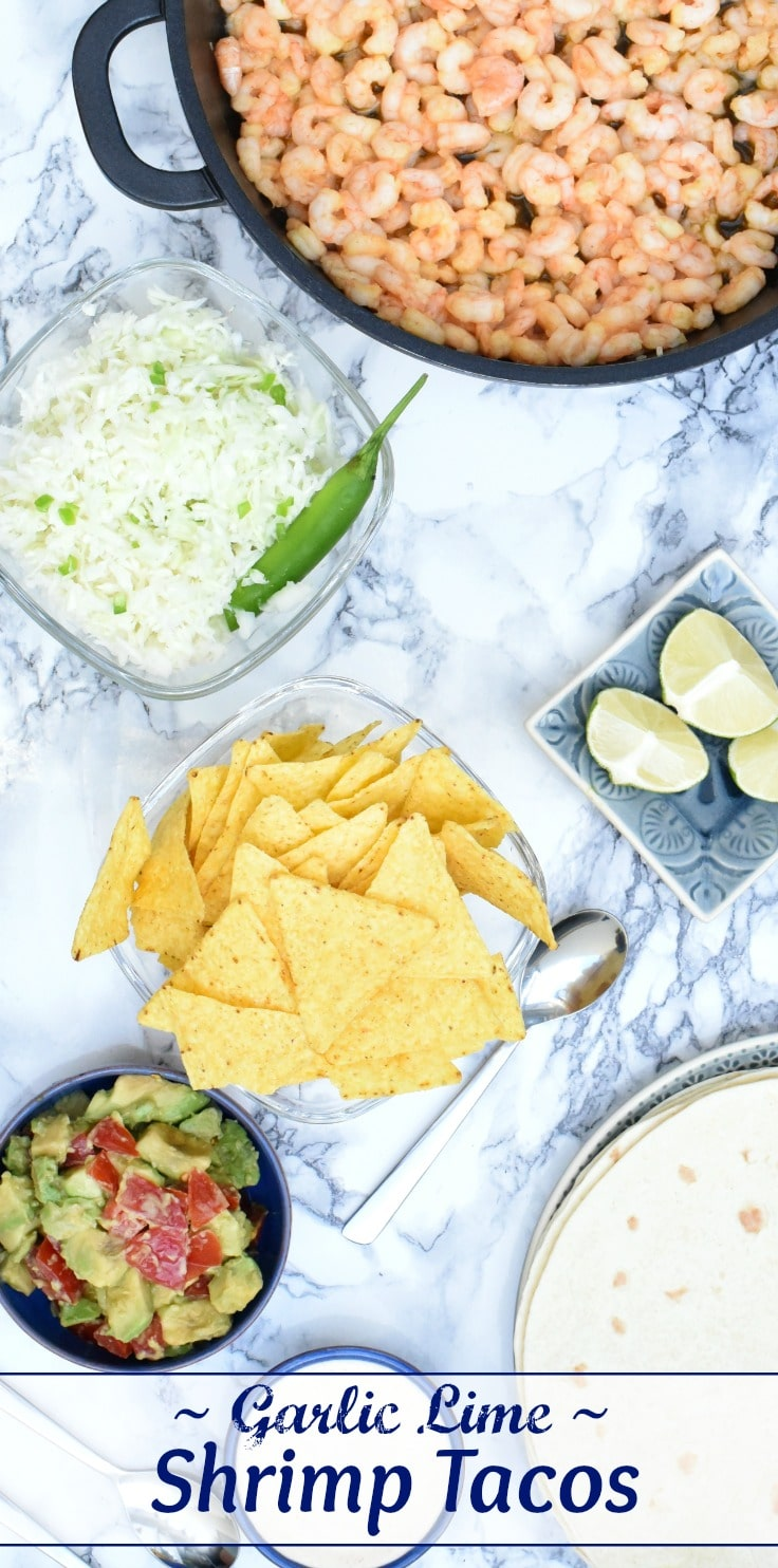 Easy Shrimp Tacos with garlic lime marinade, creamy sriracha lime sauce, avocado salsa and crunchy slaw! Simply delicious, and perfect for Taco Tuesday, tailgating parties, and quick Mexican dinners! Make-ahead options, too!   www.TwoHealthyKitchens.com