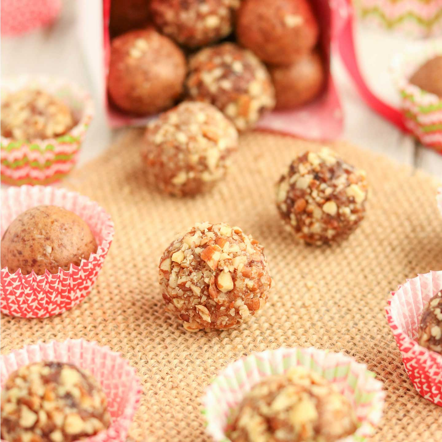 Easy no-bake holiday treats! These delicious Gingerbread Date Balls take just minutes to make! They're filled with yummy, holiday gingerbread spices - indulgent enough for holiday desserts or for pretty Christmas cookie trays, yet nutritious enough for a healthy snack! No guilt in these little indulgences! Bonus: since this date ball recipe is so quick and can be made ahead and frozen, it's perfect for last-minute, homemade DIY gifts, too! Can be made nut-free.   www.TwoHealthyKitchens.com