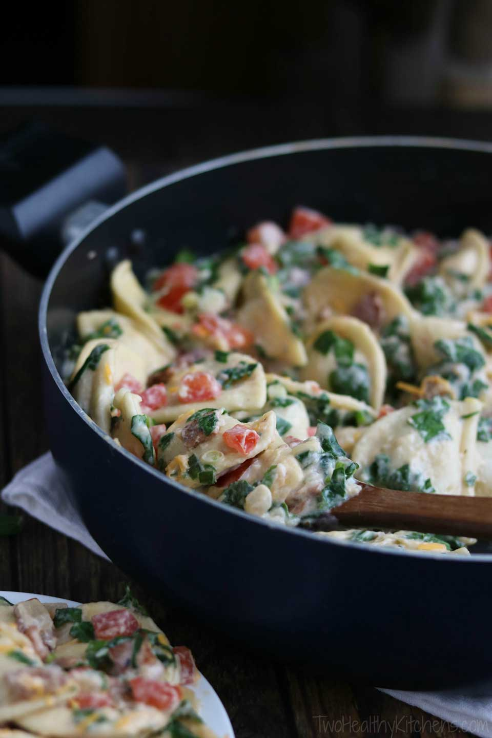 "BLT flavor + a 2-cheese ""alfredo"" sauce make this healthy, quick and easy skillet meal a family favorite! It's a 30 minute meal that can even be made ahead and quickly re-warmed later! Our Cheesy BLT Pierogi Skillet Dinner recipe is true comfort food with a satisfyingly fresh twist! Pillowy soft pierogies are draped in a creamy, rich and cheesy sauce and loaded up with vibrant BLT flavors! A deliciously healthy pierogi recipe your family will ask for again and again! 