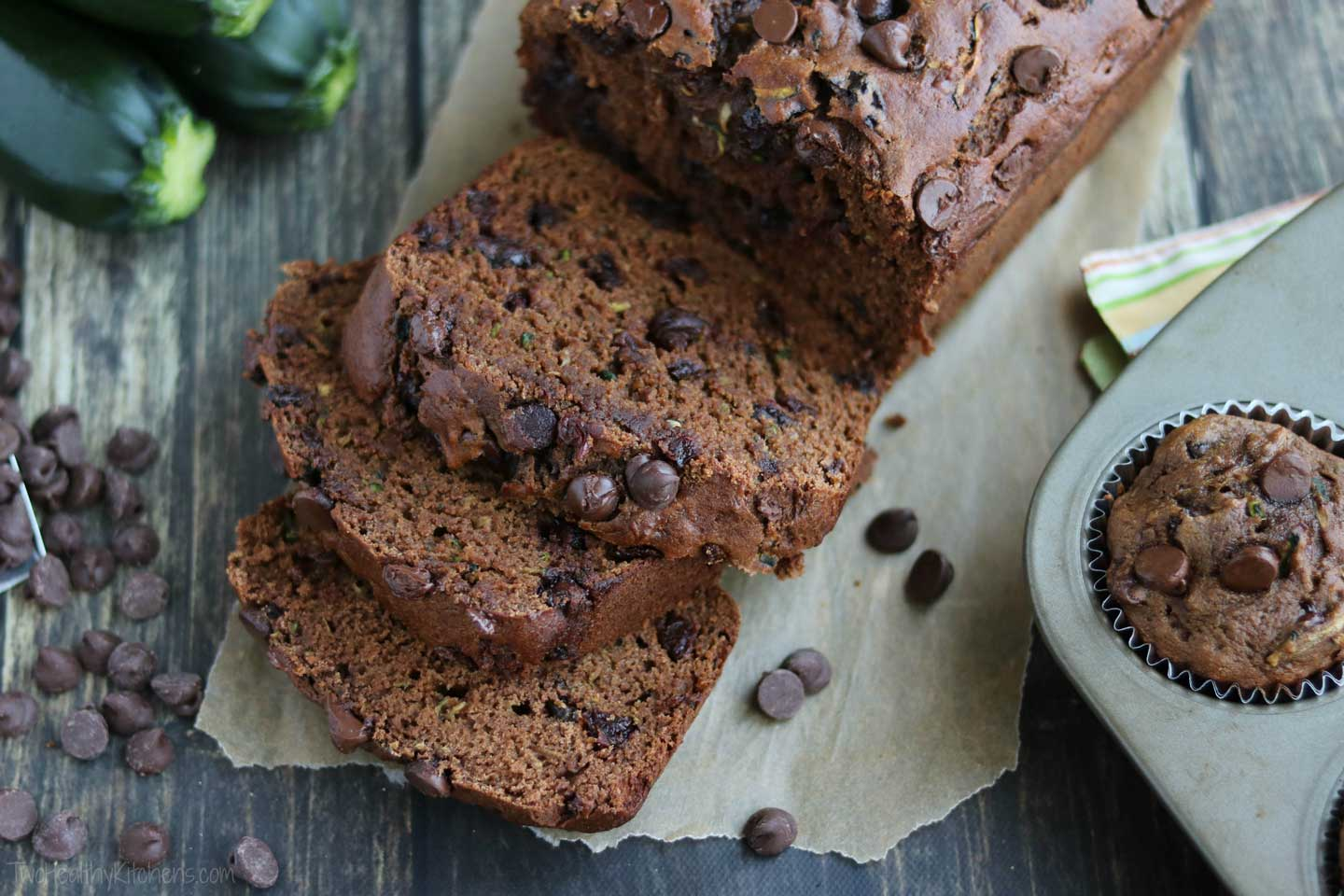 Luscious cherries & two layers of chocolate flavor! This decadent, rich Chocolate Zucchini Bread is dense, luxuriously moist, and studded with chocolate chips. Truly a chocolate lover's dream! And it's a healthy zucchini bread recipe full of whole grains and very little extra fats! For quicker baking, this is a perfect zucchini muffin recipe, too! And this easy zucchini bread freezes beautifully – make a double batch to freeze for later, or to give as homemade gifts! | www.TwoHealthyKitchens.com