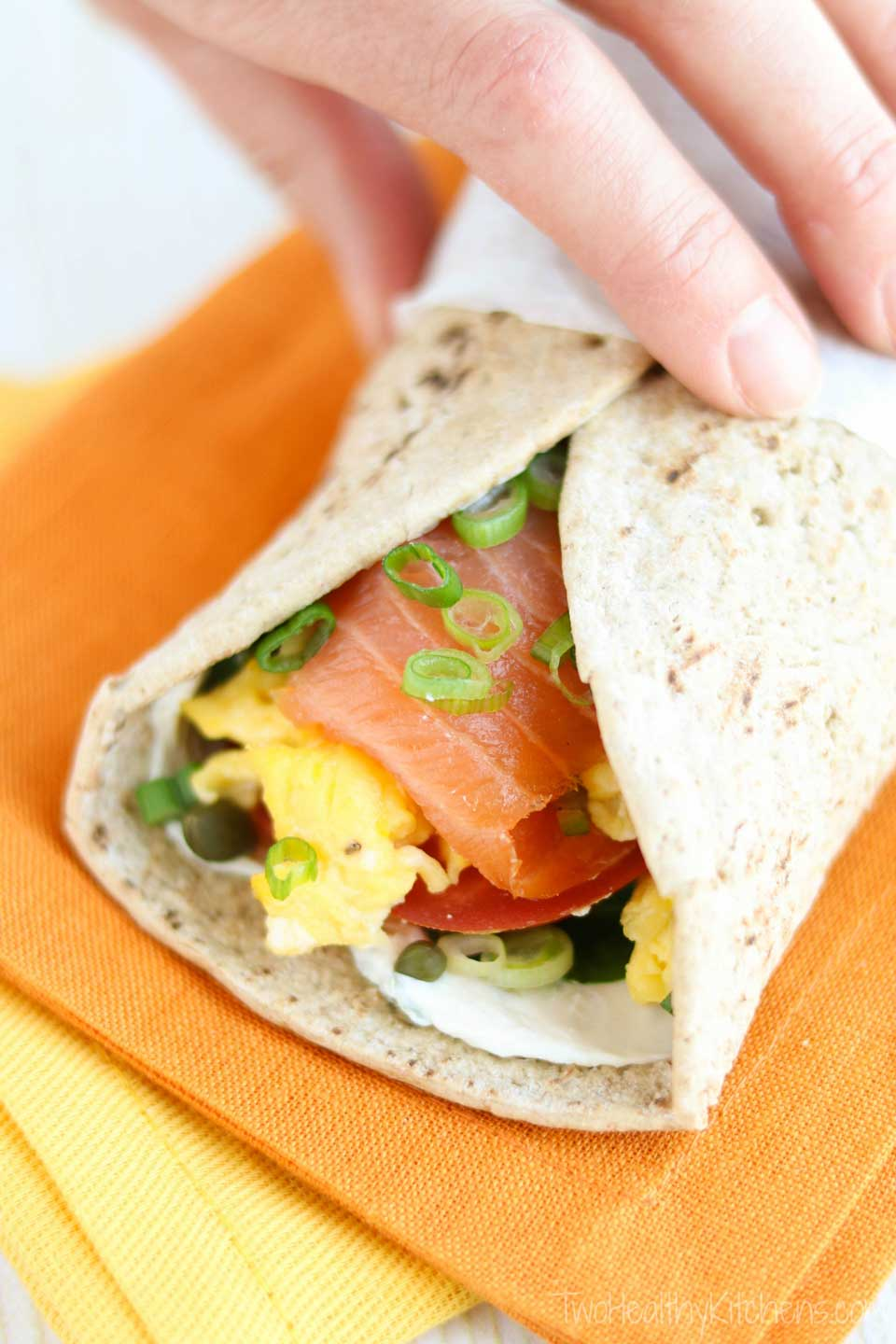 Ready in just minutes! Warm, fluffy eggs with luxurious smoked salmon, velvety cream cheese, and bright, fresh veggies – deliciously layered in this super-fast Smoked Salmon Breakfast Wrap that'll have you out the door in no time! Full of protein, fiber and veggies, it's absolutely delicious and also nutritious enough to keep you powered up all morning long! With luxurious smoked salmon, this easy breakfast wrap recipe is an upscale twist on typical egg wraps! {ad} | www.TwoHealthyKitchens.com