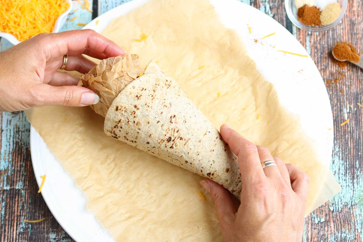 Stuffing balled-up parchment paper into the open end of the cone will help it keep its shape.