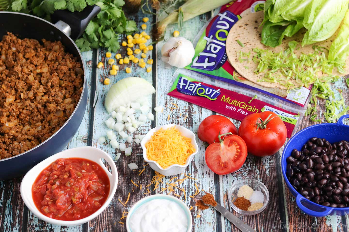 These healthy beef tacos rely on plenty of super-nutritious ingredients – lots of veggies, extra-lean ground beef, reduced-fat dairy products, and also protein-packed, fiber-rich flatbreads.