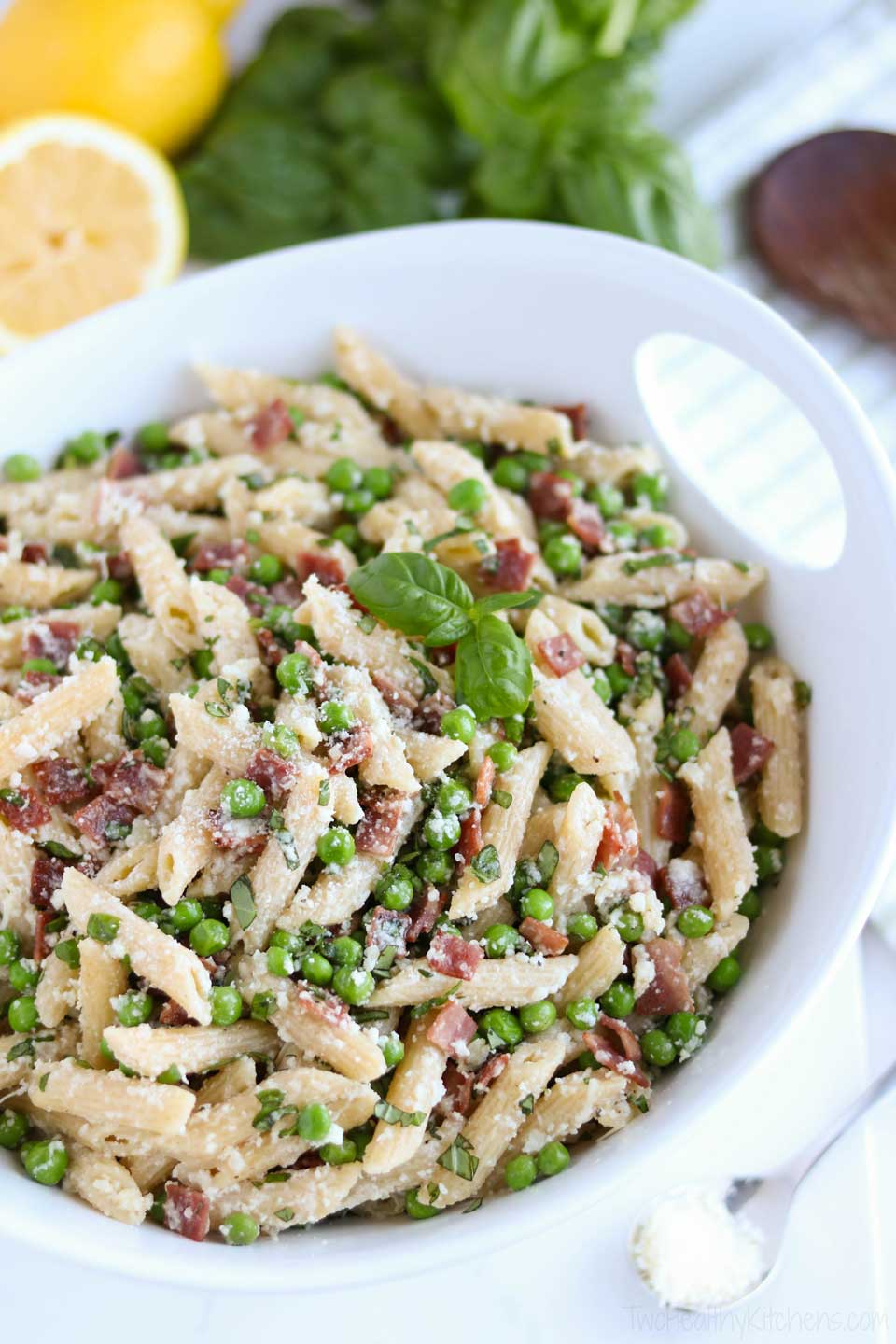 Although the original recipe for Pasta with Prosciutto was incredibly delicious, we're just as happy with this lighter Pasta and Peas recipe that makes use of turkey bacon to drastically reduce the fat.