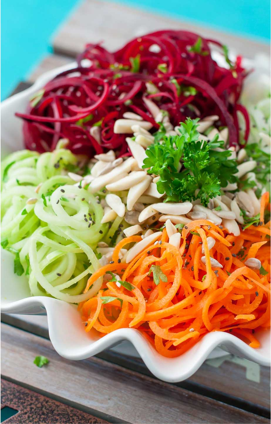This Spiralized Veggie Salad uses spiralized broccoli stalks, along with other spiralized veggies, to create a healthy, visually stunning salad recipe that brilliantly repurposes those stalks!