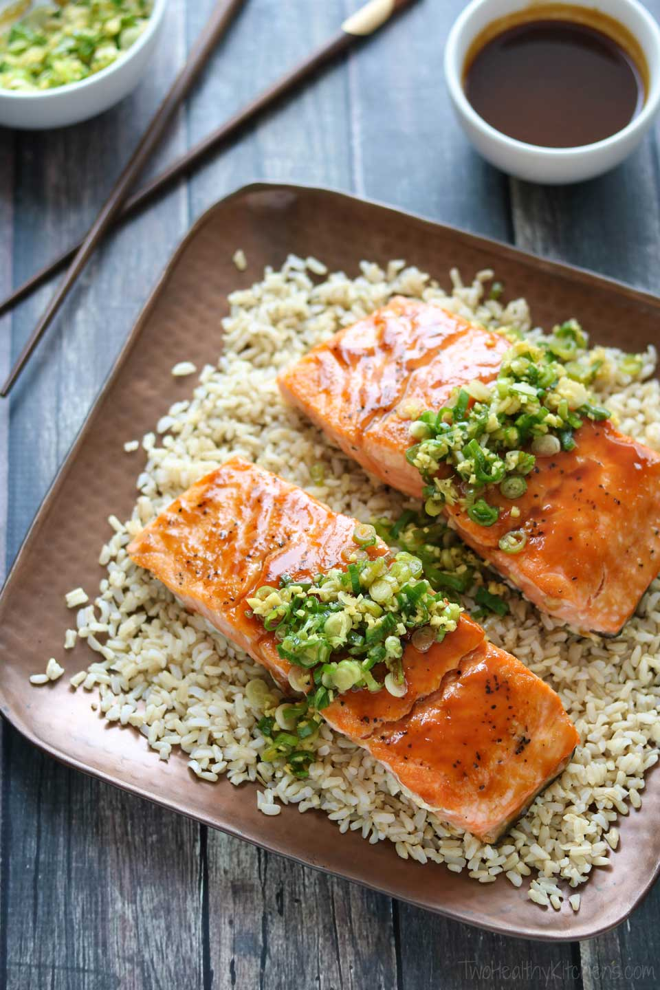 "Perfectly seared salmon is glazed with a red miso mixture, then topped with a ginger-scallion ""sauce."""