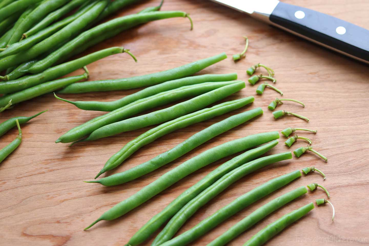 How do you trim fresh green beans? Well – that's kind of up to you! Of course, you'll want to trim away the stem end. But, whether you choose to remove the little tails, as well, is strictly personal preference. I like to leave the tails on, but you can do whichever you prefer!