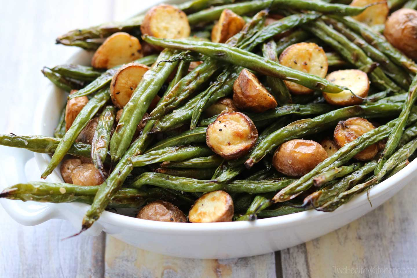Blistered green beans take on even more great flavors and textures when you mix them with roasted red potatoes. Those potatoes get perfectly crispy on the outside, fluffy on the inside. Amazing! And so very simple!