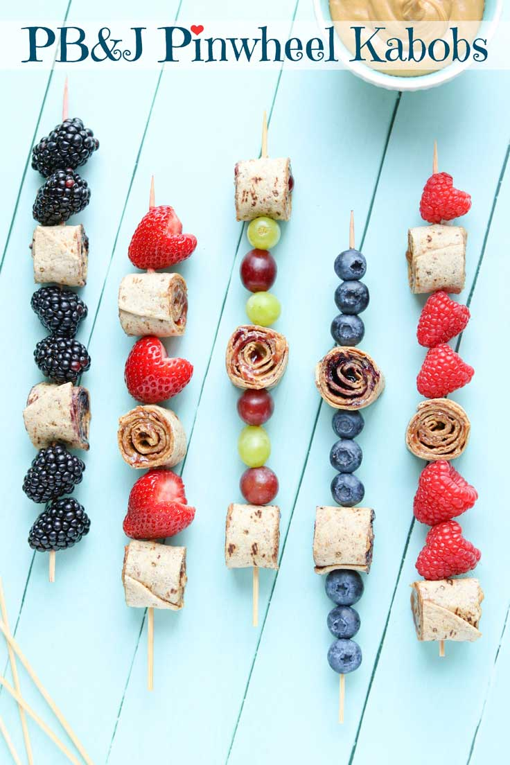 Easy and fun kids' lunch idea! So cute – they'll love this! Classic peanut butter and jelly sandwiches get a fresh twist as these PB&J Pinwheel Sandwich Kabobs! Perfect school lunch box recipe: healthy peanut butter and jelly pinwheels and fruit, together on a skewer for a fun kids' lunch recipe (with allergy-friendly, nut-free suggestions, too)! These sandwich skewers are a perfect combo of PB&J sandwich roll-ups with fun fruit kabobs! Easy school lunch idea! {ad} | www.TwoHealthyKitchens.com