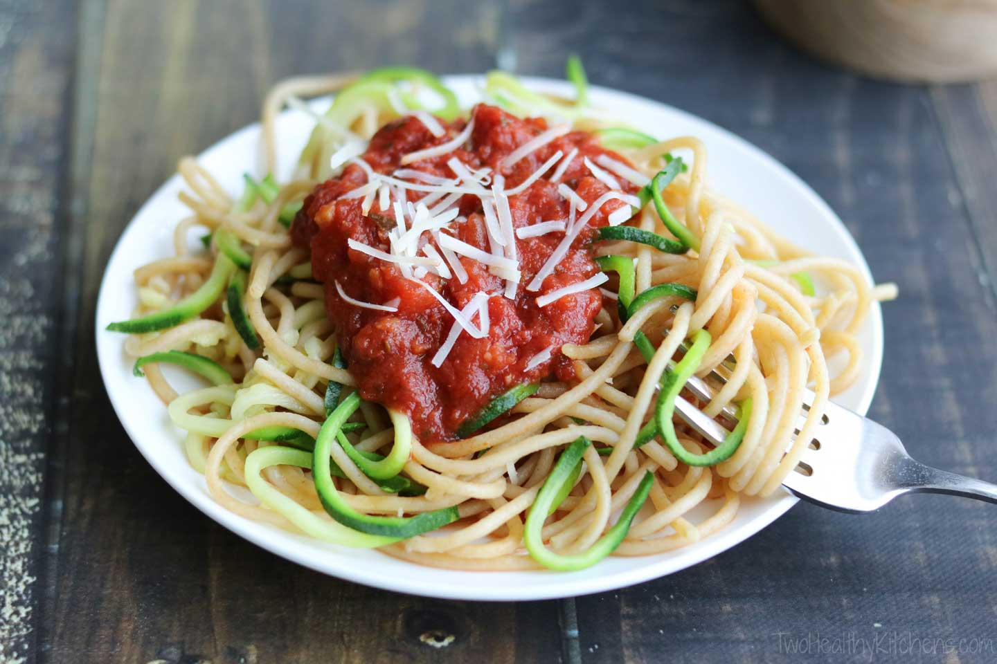 Top your zoodle and spaghetti mixture with your favorite pasta sauce, and even add a bit of shredded cheese. In minutes, dinner is served! A 15-minute meal you can feel great serving your family!