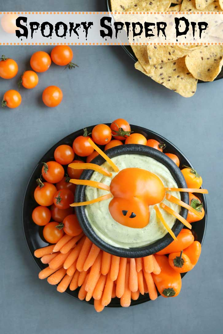 "Quick and easy Halloween idea! A total hit at Halloween parties, on appetizer buffets, or even as a fun after-school snack before trick-or-treating! This adorable ""Spooky Spider"" Halloween Appetizer Dip idea works with practically any dip – from ranch dip to other vegetable dips, even hummus or a 7-layer dip. Darling for Halloween vegetable trays, it makes a great Halloween centerpiece! Bonus: this Halloween Dip recipe idea is a HEALTHY Halloween recipe, too! 