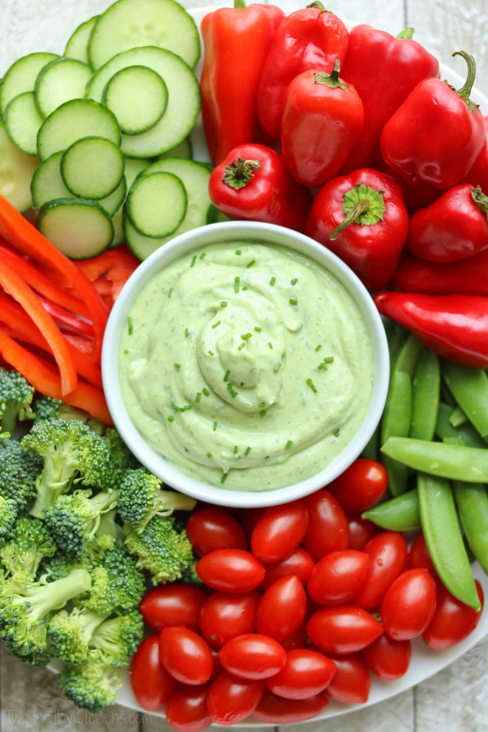 With its pretty green color, this healthy ranch dip is a perfect Christmas appetizer – great for vegetable trays, surrounded by festive red and green veggies!