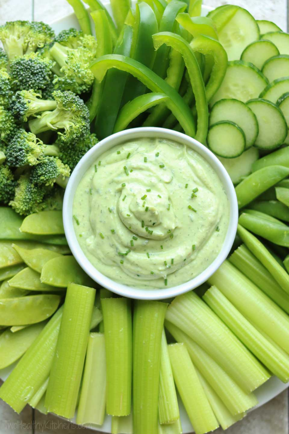 A terrific St. Patrick's Day appetizer – our green Avocado Ranch Dip is surrounded by green veggies on a fun and healthy vegetable tray!