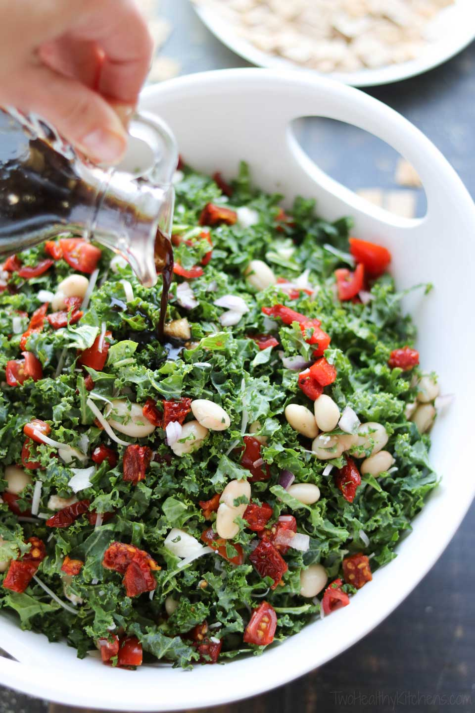 The savory and delicious Honey-Balsamic Dressing for this easy kale salad can be made in advance, so it's ready to go when you are!
