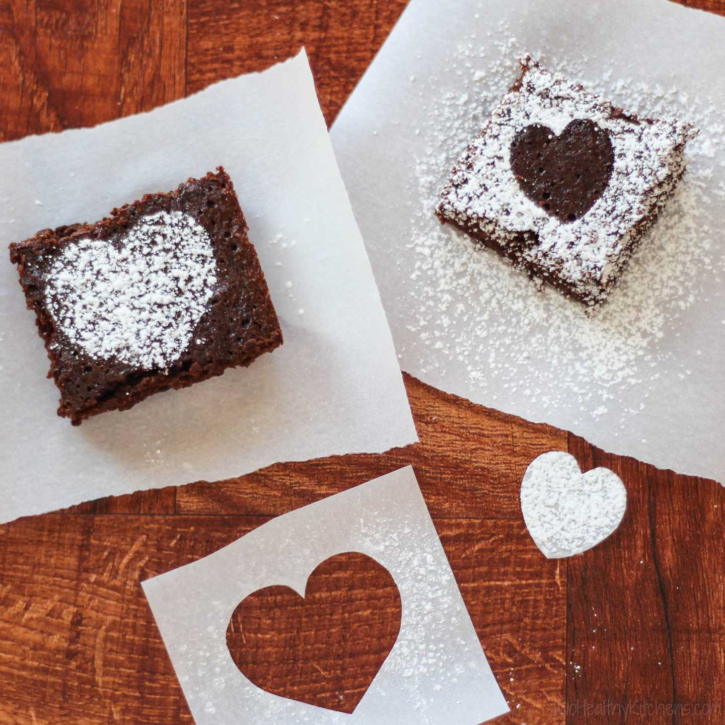 whole-wheat brownies decorated with hearts made from stencils and dusted sugar