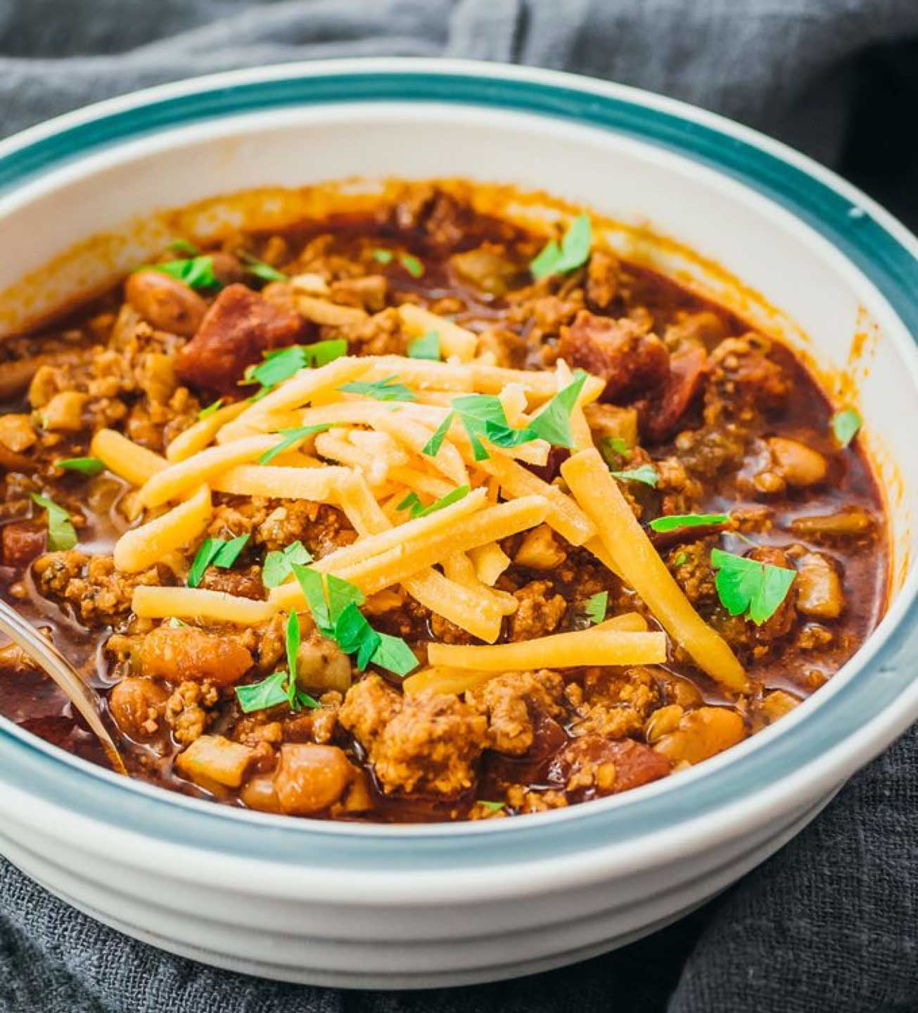 Check out this scrumptious Instant Pot Chili from Julia at Savory Tooth. (Note that, although Julia calls for lean ground beef in this recipe, she does mention an option of substituting ground turkey or chicken, if you prefer.) And be sure to check out ALL of our pressure cooker chili recipes … we've got lots more for ya!