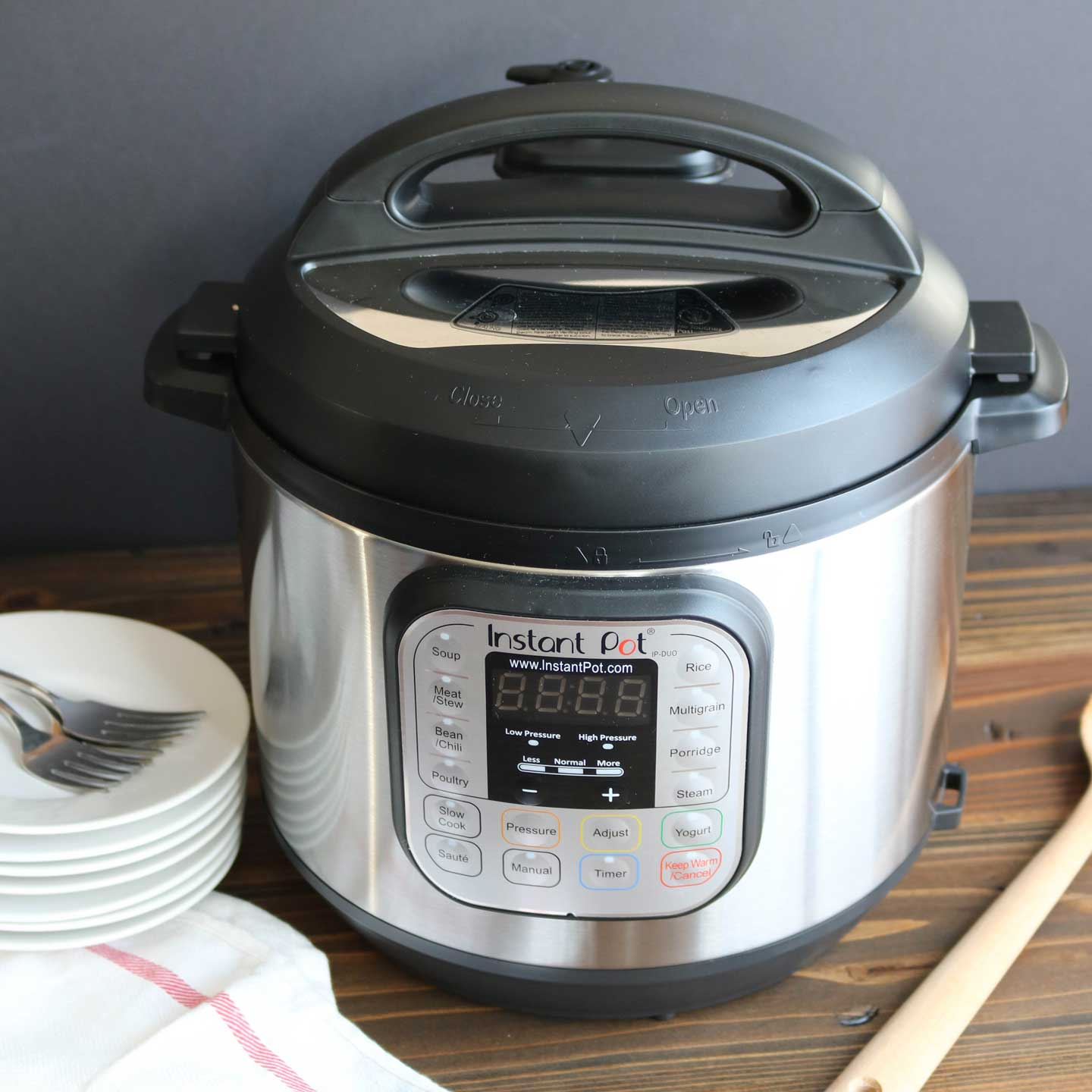 Instant Pot multi-cooker displayed near serving utensils