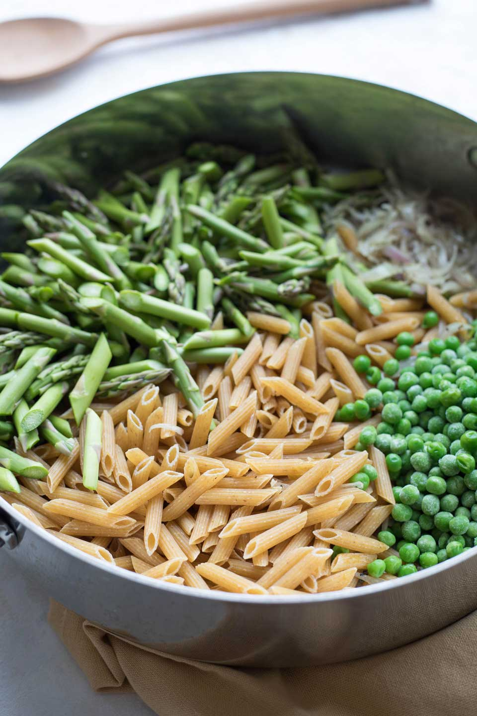 A one-pot meal that's ready in 30 minutes or less! This Whole-Wheat Pasta with Asparagus recipe is truly a busy home cook's dream!