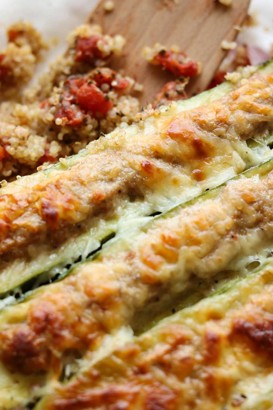 Bubbly, golden brown Italian cheeses are the perfect finish to easy stuffed zucchini filled with savory Italian sausage, all atop a quick quinoa mixture that you stir together right in the pan. An easy casserole recipe that's terrific for busy weeknights!