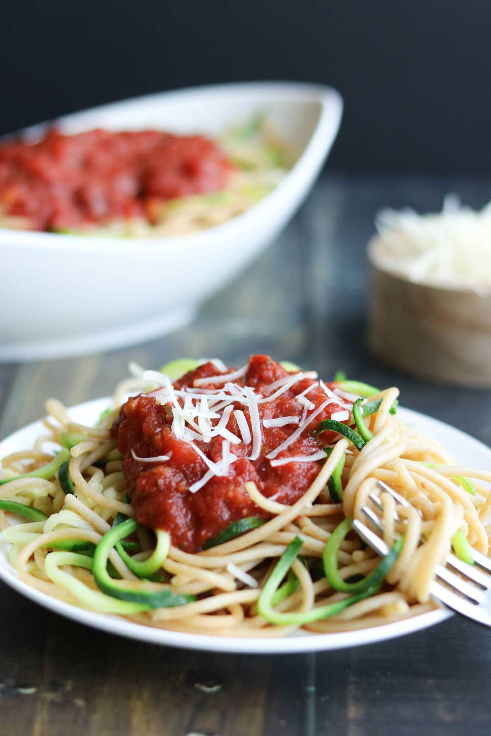 Want to try Zoodles? Here's how to start! This super-easy basic Zoodles Recipe is the perfect way to ease your family into trying Zucchini Noodles. By mixing spiralized Zoodles and spaghetti, you reap benefits all around … reduced calories and great vitamins from the zucchini noodles, plus all the fiber and whole-grain goodness of whole wheat spaghetti. Spiralizer recipes are a fun, creative way to eat more veggies … and this easy Zoodle Recipe is a great first step! | www.TwoHealthyKitchens.com