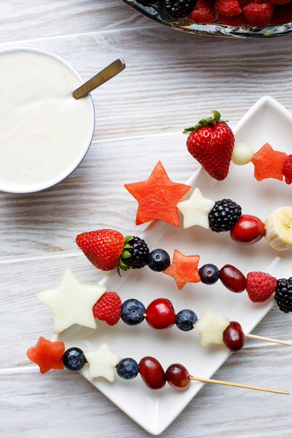 Easy and fun as appetizers or dessert! With our quick tips, you can serve Red, White and Blue Fruit Kabobs as a refreshing appetizer with sweet Yogurt Dip, or as a light but decadent dessert with cake and Chocolate Lava Dip! Plus fun serving ideas, too! Make these for all your summer picnics and BBQs ... from Memorial Day to 4th of July to Labor Day! #picnic #patriotic #redwhiteandblue #fruit #kabobs #appetizer #healthy #dessert #partyfood #4thofJuly #fourthofjuly | www.TwoHealthyKitchens.com