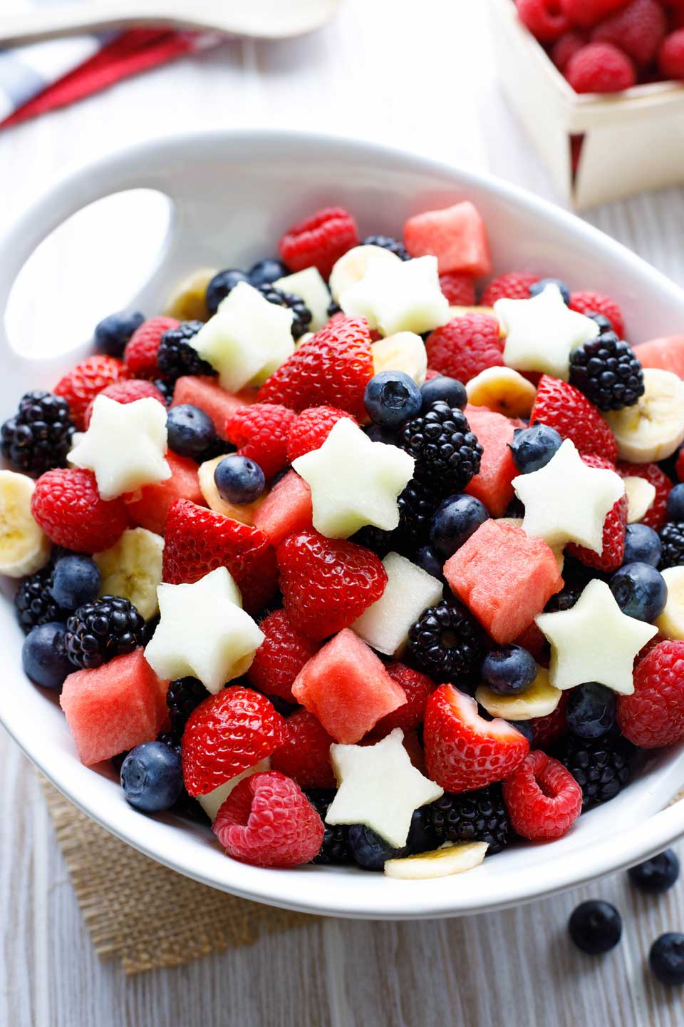 Large bowl of mixed red, white and blue fruit - decorated with little melon stars on the top