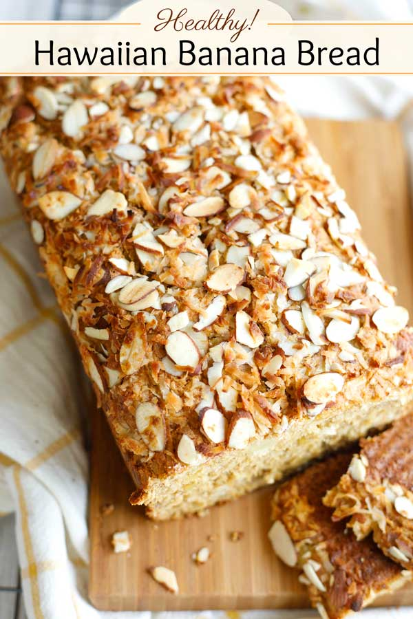 A freezable make-ahead that tastes like a tropical paradise! This Healthy Hawaiian Banana Bread doesn't TASTE healthy … it tastes like summer-y island sunshine! It's scrumptiously loaded with sweet pineapple, toasty coconut and crunchy almonds! No one will notice all the whole grains and other healthy tweaks – trust me! Make this once, and it's sure to become a new go-to family favorite! | #bananas #bananabread #breakfast #healthyrecipes #healthyfood #snack #coconut | www.twohealthykitchens.com
