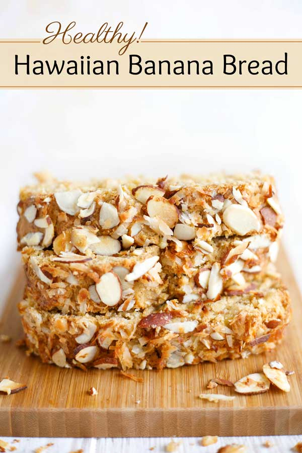 The flavors of a tropical paradise! This Healthy Hawaiian Banana Bread doesn't TASTE healthy … it tastes like summer-y island sunshine! A freezable make-ahead, it's scrumptiously loaded with sweet pineapple, toasty coconut and crunchy almonds! No one will notice all the whole grains and other healthy tweaks – trust me! Make this once, and it's sure to become a new go-to family favorite! | #bananas #bananabread #breakfast #healthyrecipes #healthyfood #snack #coconut | www.twohealthykitchens.com