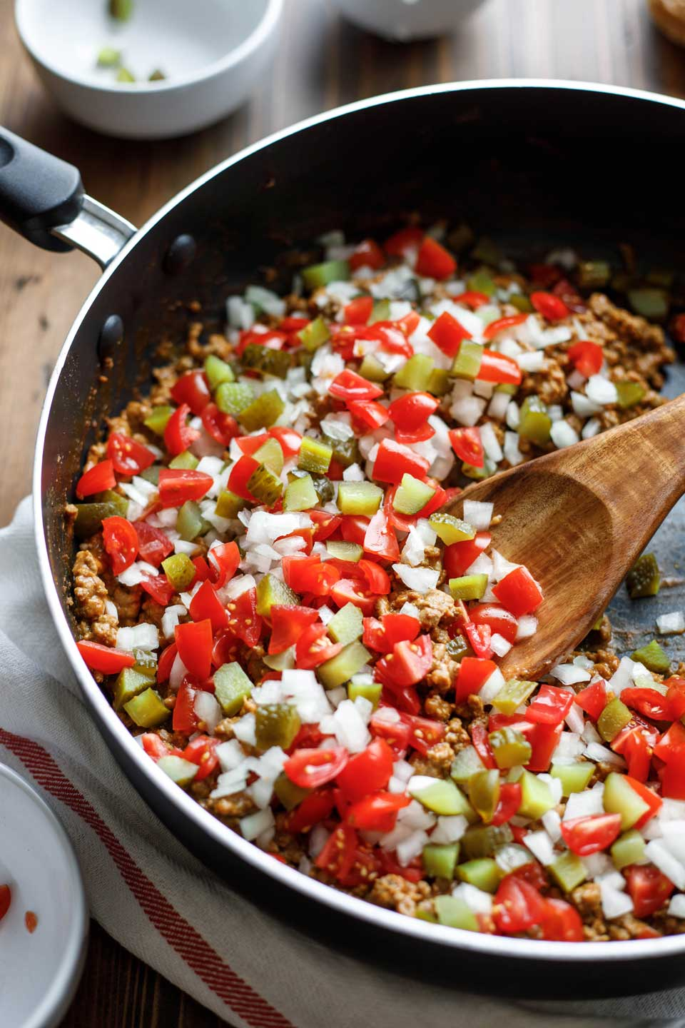 Stir crunchy onions, juicy tomatoes and sweet pickles into your Cheeseburger Sloppy Joes at the last minute - just like you'd throw them on top of a cheeseburger!