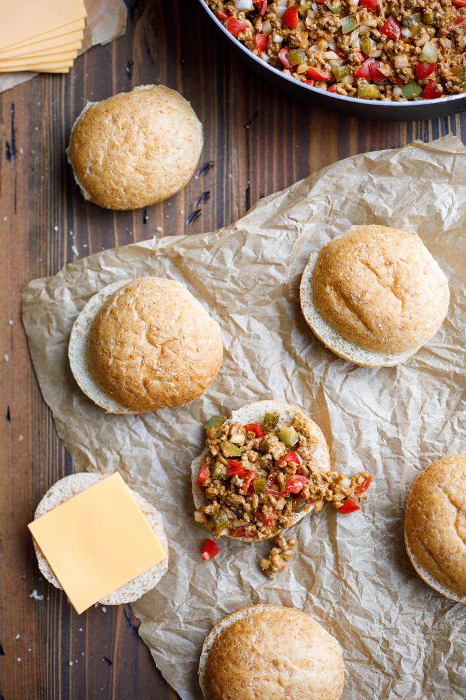 Just spoon that delicious sloppy cheeseburger goodness onto whole grain buns and top it with some cheese!