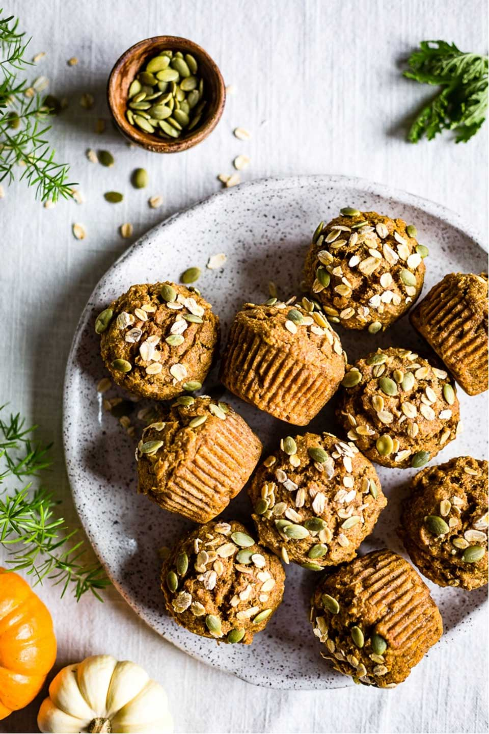 "From paleo to gluten free, sugar free to whole grain! No matter what ""healthy"" means to you, we've got pumpkin muffins you'll love! Unique flavor combos and lots of decadence … but so nutritious, too! These healthy pumpkin muffin recipes are easy to make – whip one up for quick breakfasts or healthy snacks! 