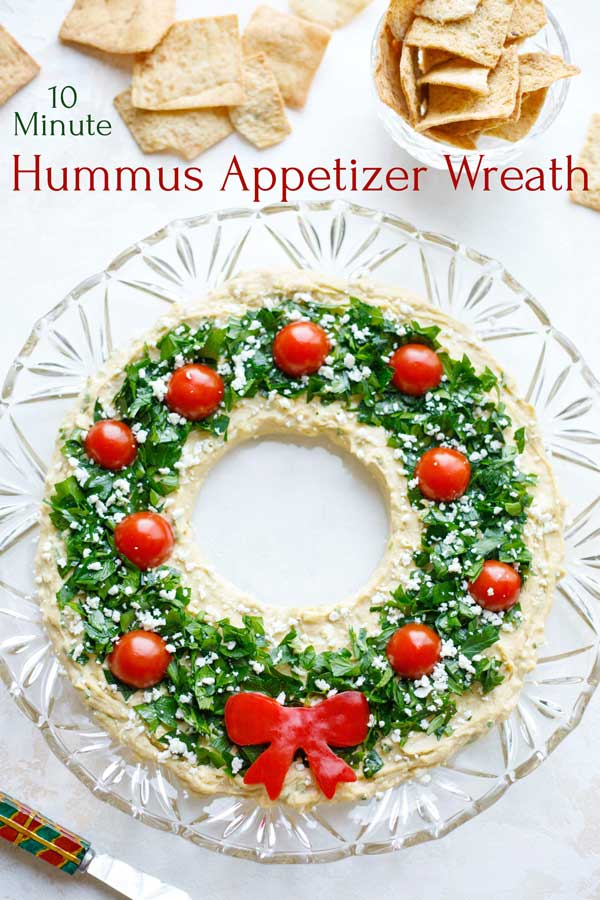 "SO EASY but sure to be the showstopper on your holiday buffet table! Our ""Hummus Wreath"" Christmas appetizer recipe is ready in just minutes, and you can even make it ENTIRELY AHEAD! Loaded with big flavor and guilt-free nutrition, this wins raves every time we serve it! Impress your friends and family this holiday season with this stress-free recipe! 