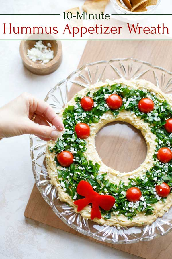 "So quick to make, but guaranteed to impress everyone at your holiday party! BONUS: this EASY Christmas Appetizer ""Hummus Wreath"" can be made completely ahead – such a lifesaver during the busy holiday season! If you're looking for Christmas party food ideas and appetizer recipes that are sure to delight your guests, definitely add this to your menu plan! 