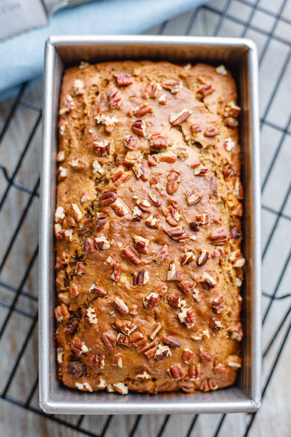 Overhead of a final baked loaf of this Banana-Nut Bread recipe on a cooling rack