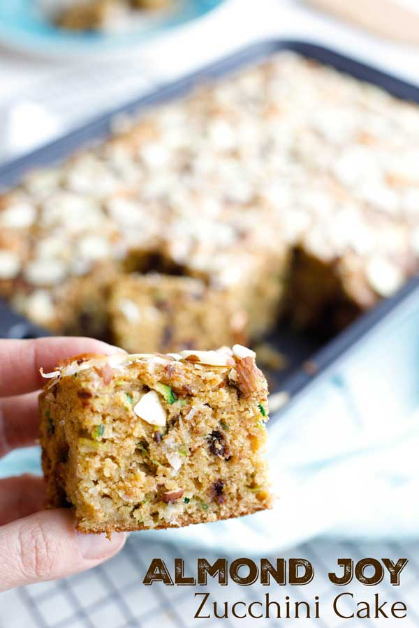 Tender cake loaded with the beloved almond, chocolate and coconut flavors of an Almond Joy candy bar! If you love zucchini bread, this recipe is a must-try! Bonus: it's actually much healthier too, with whole grains and way less fat (but don't worry – no one will ever know)! Nutritious enough for an afternoon snack … but indulgent enough for dessert! Try it with ice cream for an unforgettable treat! | zucchini recipes healthy | almond joy cake | almond joy bars | www.TwoHealthyKitchens.com