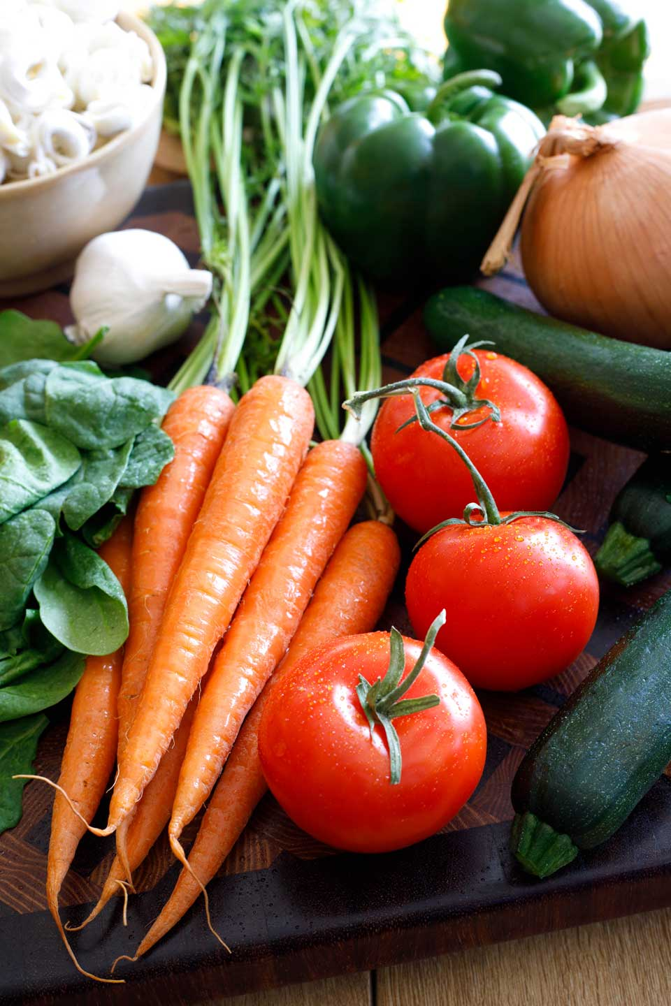 fresh produce like carrots, tomatoes, zucchini, onions, spinach, garlic, and green peppers